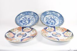 Pair of Japanese Imari style dishes and two further Japanese blue and white decorated dishes (4)