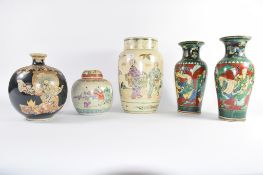 Group of Oriental pottery wares including a large vase with figures, further pair of vases with