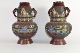 Pair of Oriental vases with cloisonne type decoration with elephant head handles, 33cm high (2)