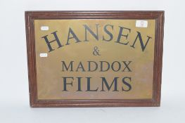 BRASS SIGN FOR HANSON & MADDOX FILMS IN WOODEN FRAME