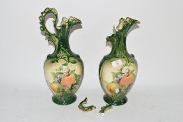 PAIR OF POTTERY EWERS, GREEN GLAZED, WITH FRUIT DECORATION