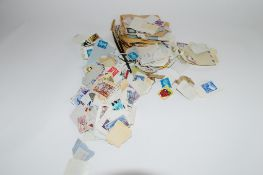 SMALL PLASTIC BAG CONTAINING QUANTITY OF LOOSE STAMPS