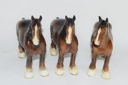 GROUP OF THREE BROWN COLOURED POTTERY CARTHORSES IN BESWICK STYLE