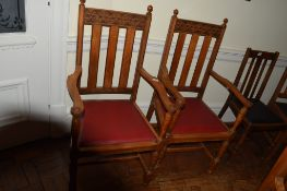 Set of eight early 20th century carved oak armchairs with red leather seats (8)