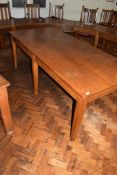 Large early 20th century long oak office table on six square tapering legs