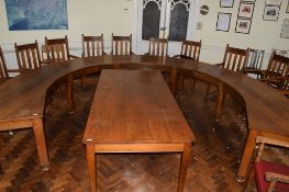 Set of three early 20th century oak committee tables of curved design, each on four chamfered square