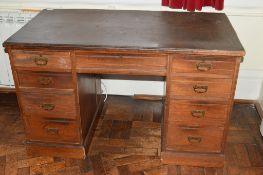 Late Victorian walnut, twin pedestal 9-drawer desk with brass drop handles (applied composition top)