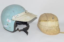 OLD STYLE 1960S SCOOTER HELMET TOGETHER WITH SIMILAR 1950S MOTORCYCLE HELMET