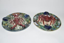 PAIR OF PORTUGUESE MAJOLICA STYLE DISHES, ONE MODELLED WITH A LOBSTER, THE OTHER WITH A CRAB