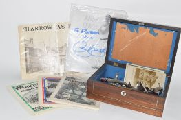 BOX CONTAINING HAIR CLIPPERS AND A BOOKLET ON HARROW HISTORY