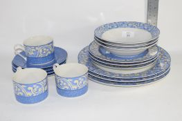 PART TEA SET IN A BLUE DESIGN COMPRISING DINNER PLATES, SIDE PLATES, BOWLS, 3 CUPS AND SAUCERS