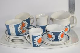 NORWEGIAN CERAMIC PART TEA SET IN THE DAISY PATTERN COMPRISING CUPS AND SAUCERS, ONE LARGE JUG,