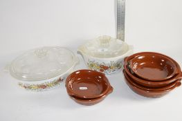 TWO PYREX DISHES AND A SMALL BROWN GLAZED CERAMIC DISHES