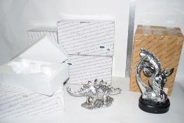 SCULPTURES FROM NATURECRAFT INCLUDING A GIRAFFE HEAD, DINOSAUR STEGOSAURUS ETC, IN ORIGINAL BOXES