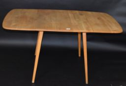 Mid-century Ercol light oak drop leaf dining table with four chairs (two pairs), table 137cm wide