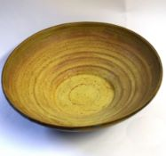 Studio pottery bowl with ridged interior, the exterior with a grey slip, 27cm diam