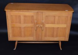 Mid-century light oak Ercol sideboard, two doors with central sliding catch, Ercol stamp to inside