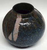 Raku ovoid vase by Christa Maria Herrmann (potting 1987-1997) decorated with a streaked design on