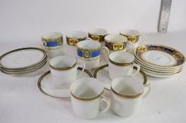 QUANTITY OF DECORATIVE COFFEE CANS AND SAUCERS