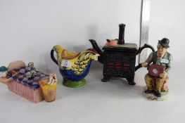 THREE VARIOUS NOVELTY TEA POTS INCLUDING A WOOD CHICKEN, A SOUTH WEST CERAMICS KITCHEN STOVE AND A