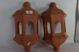 TWO TERRACOTTA CANDLE SCONCES