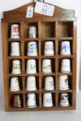 THIMBLES MOUNTED WITHIN A SMALL WALL UNIT