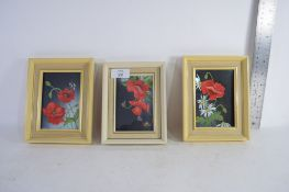 SET OF THREE SMALL FRAMED PICTURES OF FLOWERS