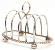 Edward VIII silver toast rack of oval form, four hoop divisions with central circular carrying