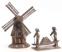 Mixed Lot: novelty Dutch white metal windmill, 7cm tall, together with a Continental white metal