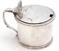 George IV silver drum mustard, the hinged lid with shell thumb piece and capped scroll handles,