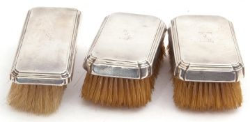 Group of three silver backed brushes, rectangular form, each engraved with a personalised