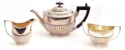 Silver three-piece bachelor's tea service of oval form comprising tea pot, twin handled sugar bowl