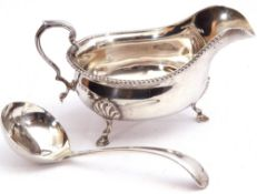 Mixed Lot: George V silver sauce boat of typical form, gadrooned rim with capped scroll handle,