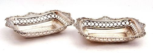 Pair of late Victorian silver bon-bon dishes of rectangular form, with pierced and embossed