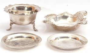Mixed Lot: Edward VII silver bowl of squat circular form with card cut wavy rim standing on three