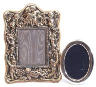 Mixed Lot: an ornate EPNS photograph frame, heavily embossed with cherubs and flowers, easel back,