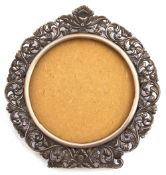 White metal photograph frame of circular form, a foliate pierced design stamped verso 800 and H.