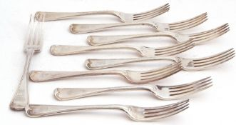 Set of nine Edwardian table forks in threaded Hanoverian pattern, each bearing a rampant lion crest,