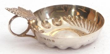 Elizabeth II silver wine taster, the circular bowl with traditional beading and fluting, the ring