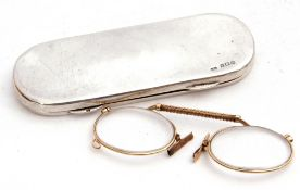 George V silver spectacle case with full length hinge, opening to a velvet lined interior containing