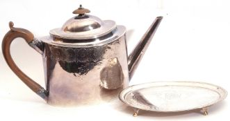 George III oval tea pot engraved with medallions, leaves and two vacant cartouches, having angular