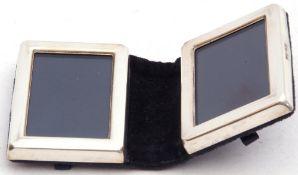 Modern white metal folding small double photograph frame in a blue velvet case, 7 x 5cm, London,