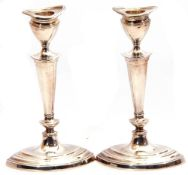 Pair of silver candlesticks of oval form, detachable reeded sconces, tapering knopped stems on a