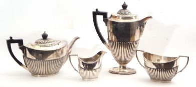 Late Victorian silver tea and coffee service comprising a coffee pot and tea pot, both with ebonised