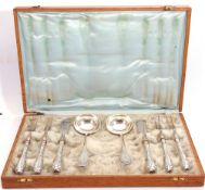 Art Deco period oak cased set of Continental silver/silver handled serving items including pair of