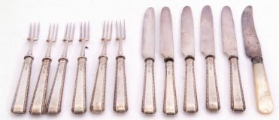 Set of six George V silver handled fruit forks with plated prongs, together with five matching
