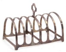 George V silver toast rack of rectangular form, six divisions and central pierced carrying handle