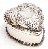 Late Victorian silver heart shaped trinket box, the hinged lid embossed with scrolls etc and crimped