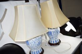PAIR OF TABLE LAMPS WITH CHINESE PORCELAIN VASES AND COVERS AND WOODEN STANDS CONVERTED FOR