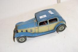 LARGE TIN PLATE CLOCKWORK MODEL OF A CAR